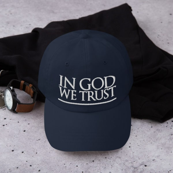 in god we trust - American Czar - <h3>In God We Trust National Motto hat</h3> 'In God We Trust' is more than just our national motto – it's our foundation and identity as Americans. This declaration was adopted as the official motto of the United States by Congress in 1956. Wear it proudly! Dad hats aren't just for dads. This one's got a low profile with an adjustable strap and curved visor.